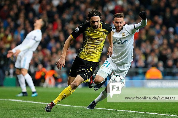 MADRID  SPAIN - Neven Subotic and Borja Mayoral. Real Madrid brought the curtain down on their group-stage campaign with a 3-2 victory over Borussia Dortmund in a game that saw Cristiano Ronaldo become the first player to find the net in each of the six group-stage matchdays. Borja Mayoral  Cristiano Ronaldo and Lucas Vázquez struck after the break to seal the win. Pierre-Emerick Aubameyang scored twice for the visitor team.
