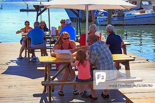 People enjoying lunch at the StarFish Company fish restaurant in Bradenton FL USA.
