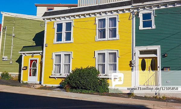 Typical traditional bright yellow timber house  St John's  Newfoundland  Canada.