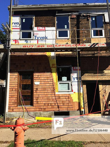 The exterior of a two-storey house undergoing extensive refurbishing  Halifax  Nova Scotia  Canada.