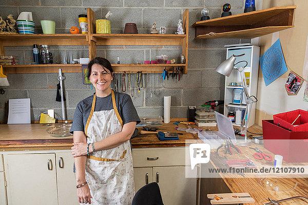 Portrait of jewellery maker in workshop