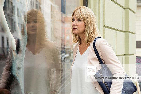Woman window shopping shop window