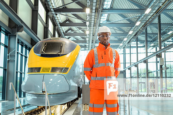 Portrait of male apprentice at railway engineering facility