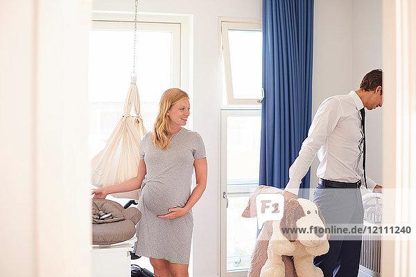 Pregnant couple preparing nursery