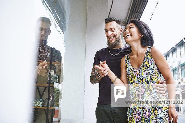 Multi ethnic hipster couple window shopping  Shanghai French Concession  Shanghai  China