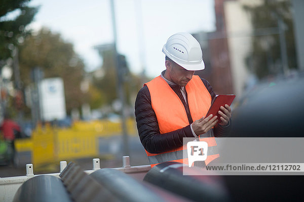 Road engineer using digital tablet