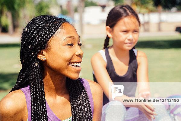 Schoolgirls taking a break on school sports field
