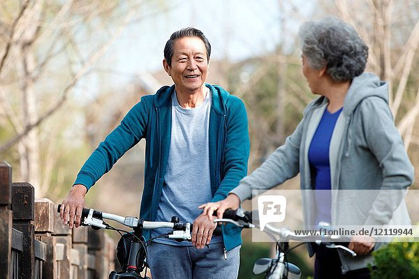 Outdoor riding bicycle for old couple