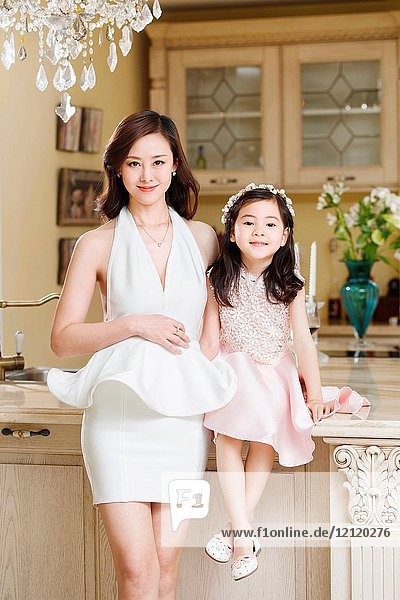Fashionable dress mother and daughter