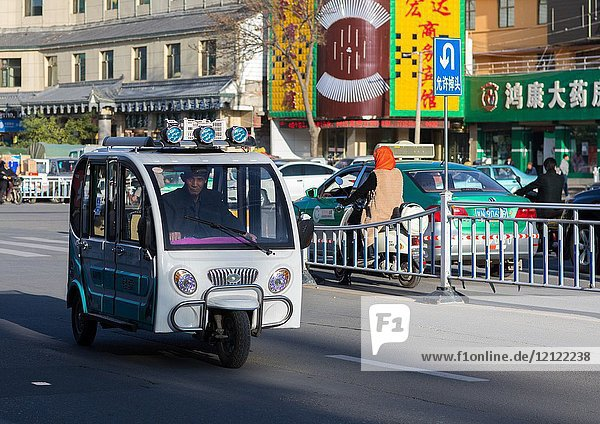 Small taxi in downtown  Gansu province  Linxia  China.
