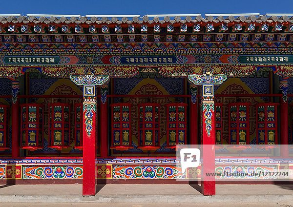Beautifully painted and adorned prayer wheels in Wutun si monastery  Qinghai province  Wutun  China.