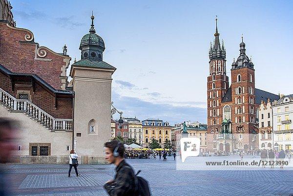 St. Mary's Basilica and Sukiennice Cloth Hall  at main Market Square Rynek Glowny  Krakow  Poland.