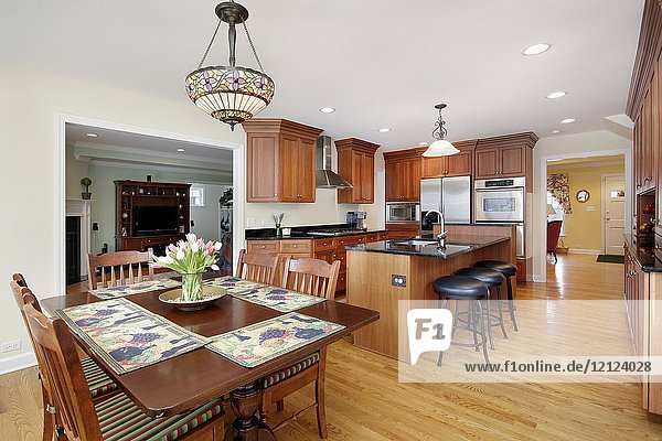 Kitchen with cherry wood cabinetry and eating area near Chicago  IL. USA.