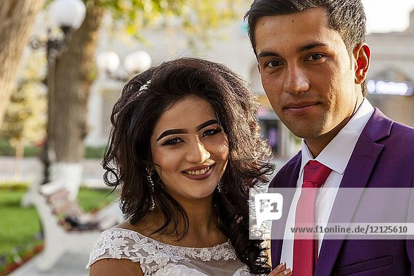 An Attractive Young Uzbek Couple Pose For A Photo After Getting Married  Bukhara  Uzbekistan.