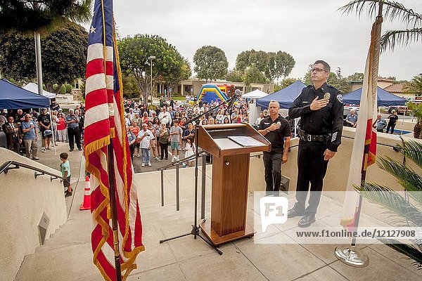 The Pledge of Allegiance is recited at a police department community anniversary festival in Fountain Valley  CA.