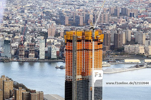 A view of One Manhattan Square  a luxury condo building under construction at 252 South Street  from One World Observatory  One World Trade Center  New York  New York  United States.