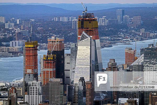 A telephoto view of new construction near the Hudson River viewed from One World Observatory  One World Trade Center  New York  New York  United States.
