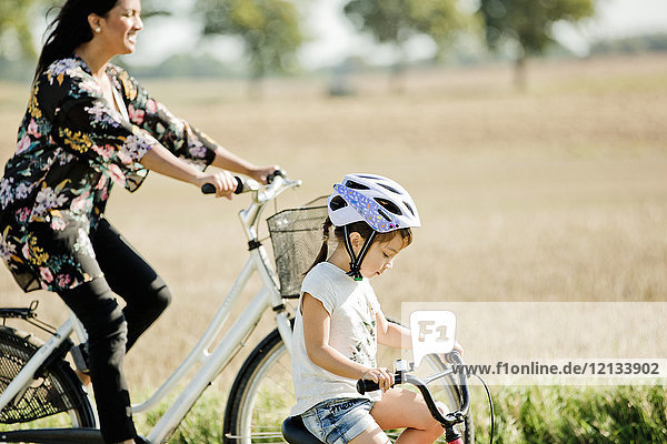 Mother and daughter cycling in Friseboda  Sweden