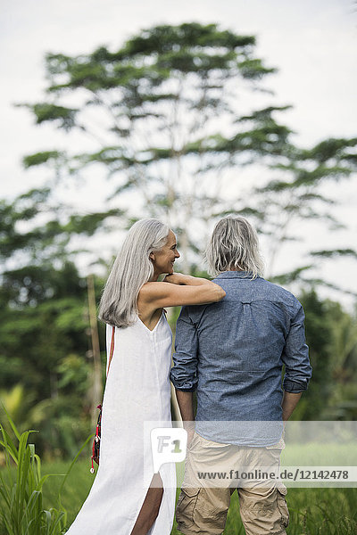 Senior couple looking at tropical landscape