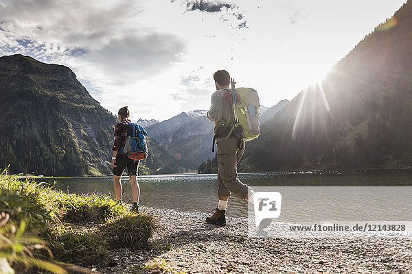 Austria  Tyrol  young couple hiking at mountain lake