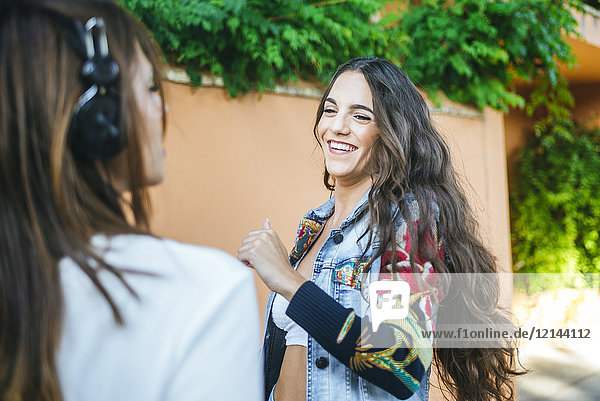 Portrait of laughing young woman dancing on the street
