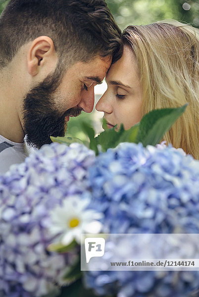 Romantic couple with a bouquet of hydrangeas