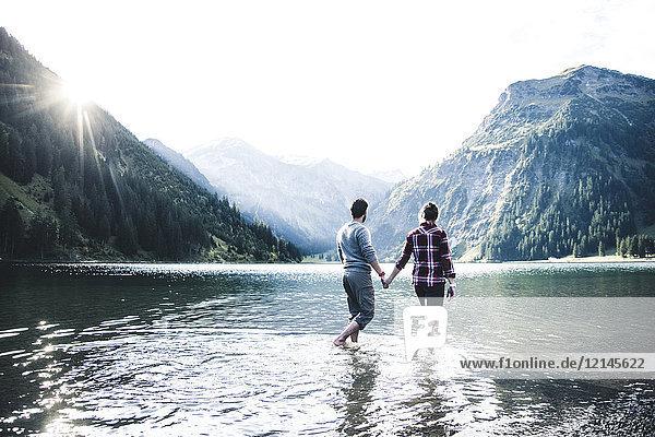 Austria  Tyrol  hiking couple refreshing in mountain lake
