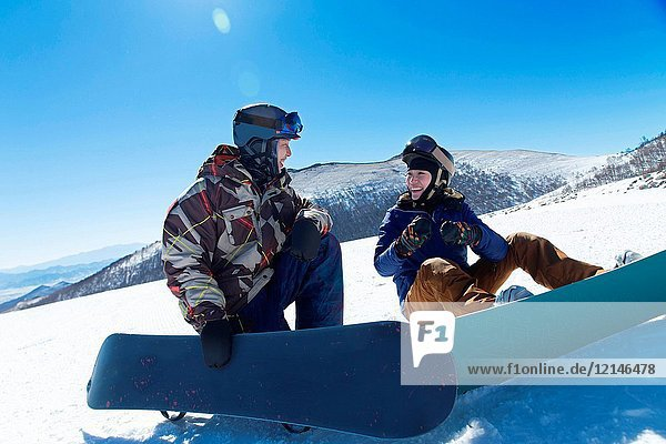 Young men and women outdoor skiing