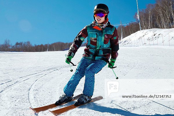 Young men outdoor skiing