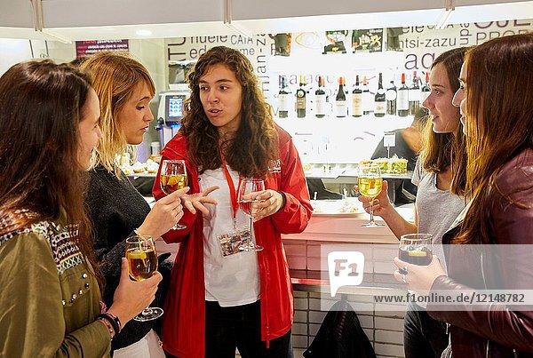 Group of tourists and guide making a tour of the city  Eating pintxos  Donostia  San Sebastian  Gipuzkoa  Basque Country  Spain  Europe