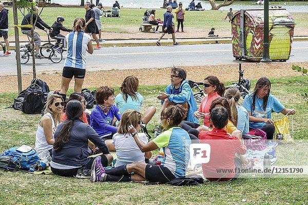 Argentina  Buenos Aires  Bosques de Palermo  Parque 3 de Febrero  public park  lawn  man  woman  fitness club  friends  group  picnic  sitting on grass  Hispanic  Argentinean Argentinian Argentine