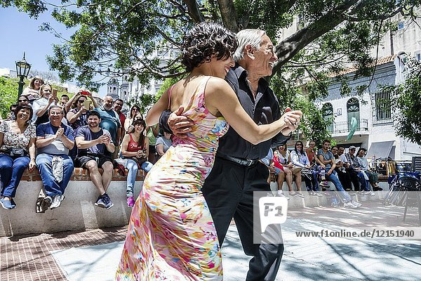 Argentina  Buenos Aires  San Telmo Plaza Dorrego  tango dancers  senior  Hispanic  man  woman  couple  dancing  audience  performance  Argentinean Argentinian Argentine