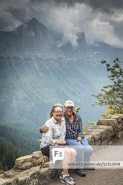 Senior tourist couple. Glacier National Park  Montana  USA.