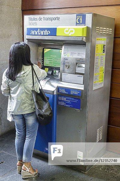 Portugal  Porto  Metro do Porto  public transport  subway  Campanha station  Andante  vending machine  fare card  woman  buying