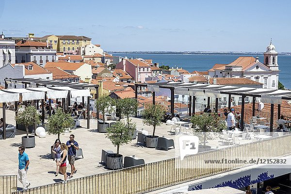 Portugal  Lisbon  Tagus River  Alfama  historic neighborhood  Miradouro das Portas do Sol  observation deck  terrace  viewpoint  skyline  rooftops  residences  apartment buildings  Portuguese Europe EU European Hispanic