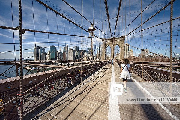 Walking on Brooklyn Bridge  New York  Usa.