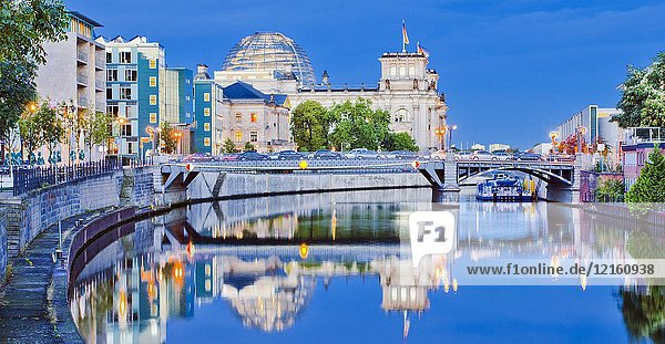 On background Reichstag  House of German Parliament  Federal Parliament Building  Government District  Spree river  Berlin  Germany  Europe.