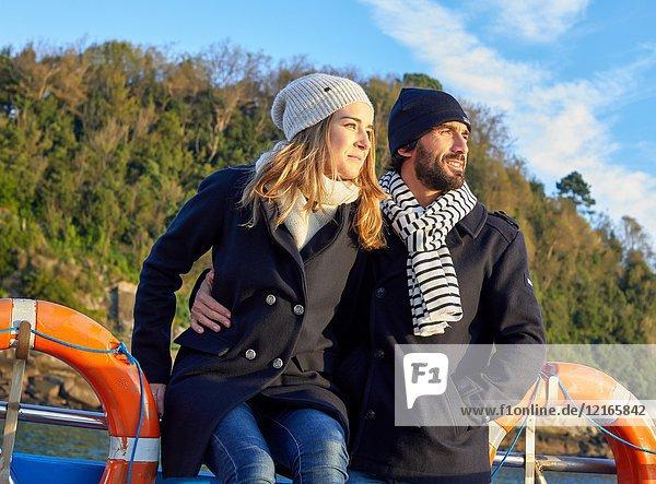 Couple on a boat trip to Santa Clara Island  Donostia  San Sebastian  Gipuzkoa  Basque Country  Spain  Europe  Winter