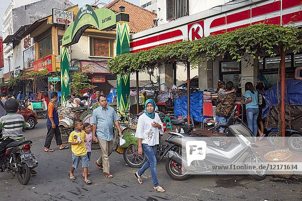 People walking along Malioboro Street. Yogyakarta  Java  Indonesia.