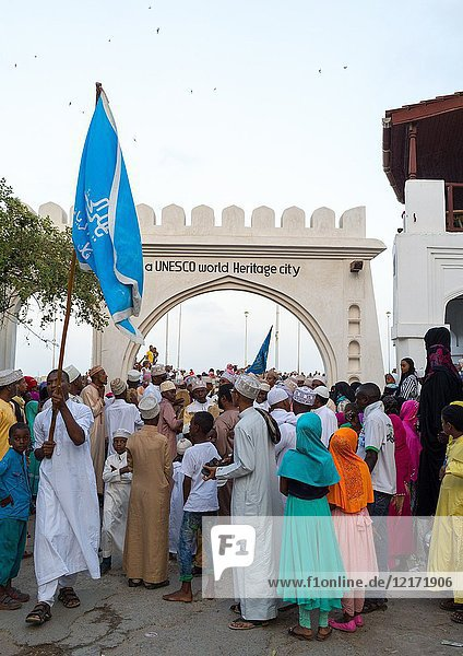 Sunni muslim people parading in front of the town gate during the Maulidi festivities in the street  Lamu County  Lamu Town  Kenya.