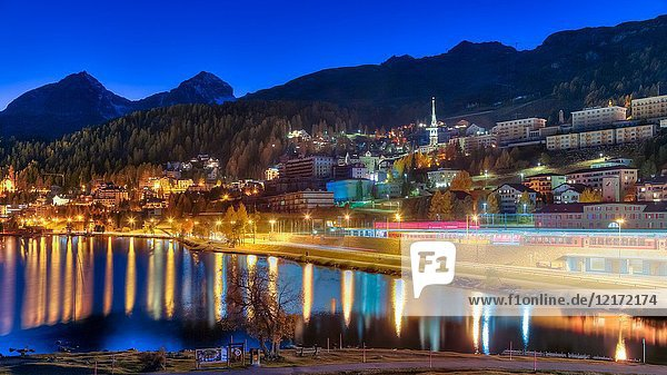 St. Moritz Lake at dusk and the luxury resort town of St. Moritz  Switzerland  Europe.