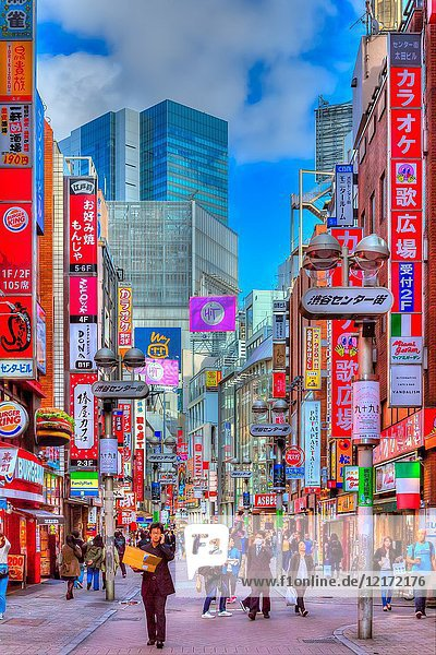 A shopping street with pedestrians in the Shibuya district of Tokyo  Japan  Asia.