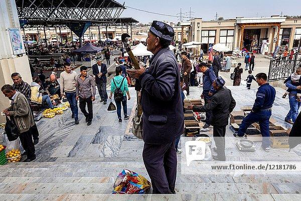 An Uzbek Man Plays Music At The Main Bazaar  Samarkand  Uzbekistan.