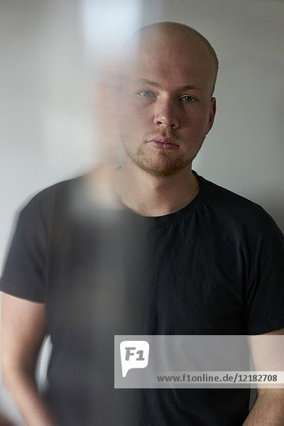 Portrait of young man. Motion of blurred wisp over half of face. Dutch ethnicity.