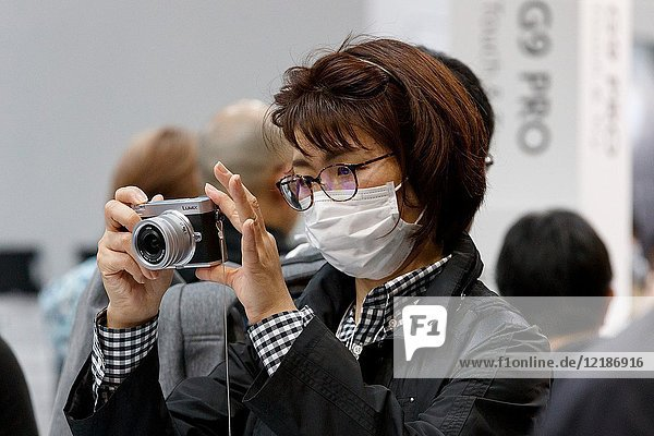 March 3  2018  Yokohama  Japan - A woman tries out the new Lumix camera DC-GX7 MK3 at the CP+ Camera & Photo Imaging Show 2018 in Pacifico Yokohama. Japan's largest camera and photo imaging exhibition bring together 1 123 exhibitor booths during the four-day trade show at the Pacifico Yokohama and OSANBASHI Hall. Organizers expect approximately 70 000 visitors until March 4th.