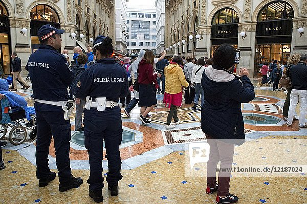 Vittorio Emanuele gallery interior  Milan  Italy. Police patrolling the interior to reinforce security.
