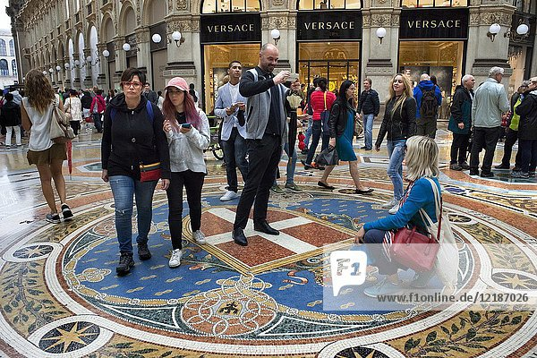 Vittorio Emanuele gallery interior  Milan  Italy. Coat of arms of the House of Savoy depicted on the mosaic floor in the Galleria Vittorio Emanuele II in Milan  Lombardy  Italy.