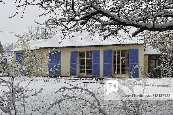 Small house with blue louver in the snow  France  Europe.