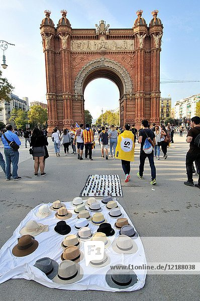 The Arc de Triomf  Triumphal Arch. Built for the Exposición Universal de Barcelona (1888)  as its main access gate by architect Josep Vilaseca i Casanovas. Built in reddish brickwork in the Moorish Revival style. Hats. Barcelona. Catalonia. Spain