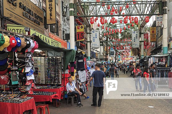 Tourists and local people visiting the Chinese Petaling Market in China Town of Kuala Lumpur.
